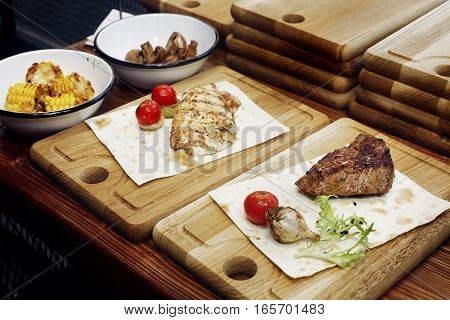 Juicy Grilled Steak With Fried  Pepper Tomato And Garlic. Serving Beefsteak On Wooden Desk. Catering