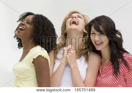 Happy diverse group of women laughing and taking.