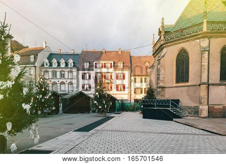 Empty Christmas Market in Thann village - in the place of the St. Thiebault Collegiate - Eastern France Aslace