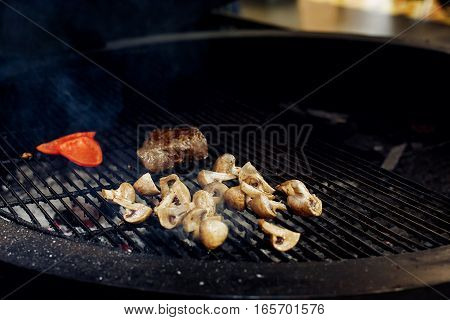 Vegetables And Meat Grilling.  Beefsteak Mushrooms  Tomatos Garlic On Grill. Catering In Food Court
