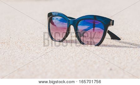 Happy Beautiful Girl Reflecting in Sunglasses on Sand Beach. Bali