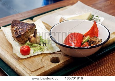 Juicy Grilled Steak With Fried Vegetables. Serving Beefsteak On Wooden Desk. Catering In Food Court
