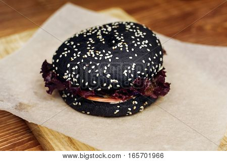 Black Burger. Serving Cheeseburger Or Hamburger With Salad On Wooden Desk. Catering In Food Court At