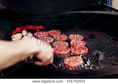 Pork Meat And Chicken Grilling For Burgers With Flames And Smoke. Catering In Food Court At Mall. Sp