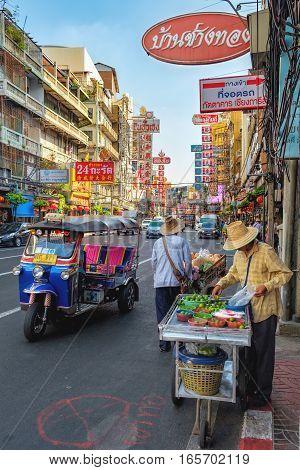 Bangkok, Thailand - December 22, 2015: Unidentified street vendor of lime in Chinatown. Yaowarat is a street food market in Bangkok.