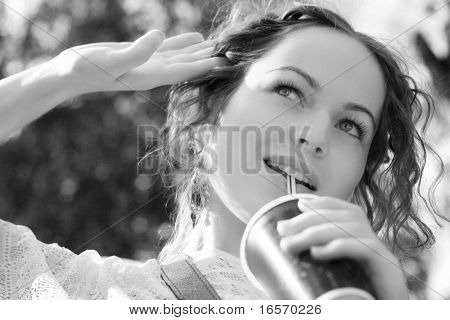 beautiful woman drink water - nature background