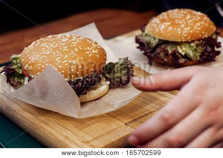 Yummy Burger. Serving Cheeseburger Or Hamburger With Salad On Wooden Desk. Catering In Food Court At