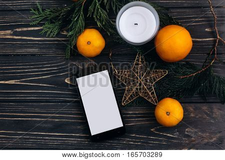 Christmas Advertising Concept Phone With Empty Screen On Christmas Background Of Green Branches And