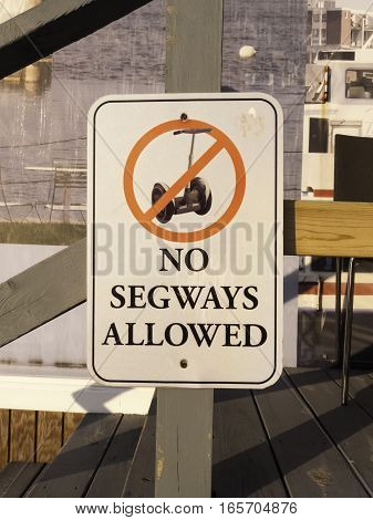South Boston Massachusetts USA - May 26 2016: Sign along Boston Harborwalk warning that no Segways are allowed