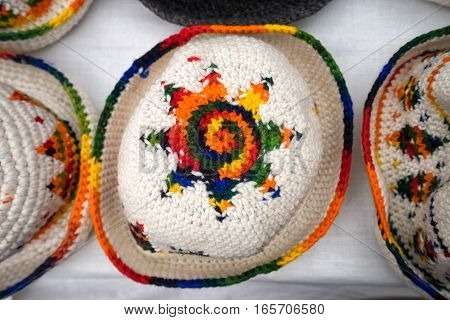 hand knitted hats in he Otavalo artisan market in Ecuador