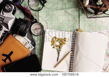 Wanderlust And Adventure Concept, Compass Camera Glasses Passport Money Notebook With Wildflowers On