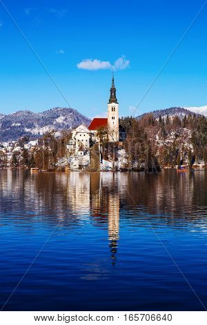 Travel Slovenia Europe. Winter landscape Bled Lake. Bled Lake one of most amazing tourist attractions. View on Island with Catholic Church