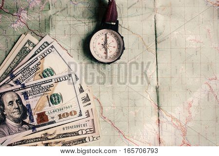 Wanderlust And Planning Summer Travel Vacation Concept, Compass And Money On Map, Top View, Vintage