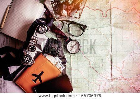 Wanderlust And Adventure Concept, Compass Camera Phone Passport Money Notebook  On Map, Top View, Sp