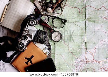 Wanderlust And Adventure Concept, Compass Camera Phone Passport Money Notebook  On Map, Top View, Sp