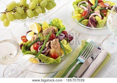 French cuisine Nicioise salad arranged on table