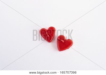 Two Heart Red Candles Isolated On White Background, Valentine Greeting Card Concept