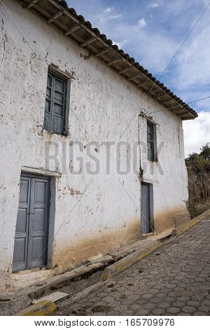 old colonial house facade in rural Ecuador