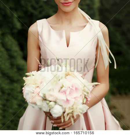 Bride Holding Wedding Bouquet Of Pink And White Flowers In Hands With Luxury Rings In Tender Rich Dr