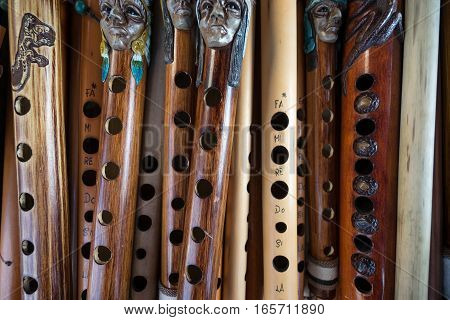 closeup of handmade indigenous flute in the artisan market of Otavalo Ecuador