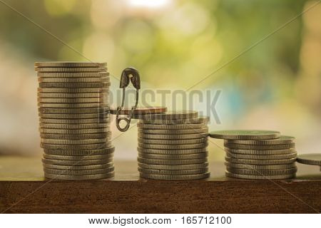 stack of coins make diferrent and joinconcept idea for business and money.