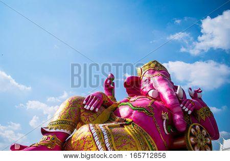 The Ganesha hindu god in blue sky background