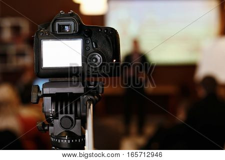 Photo Video Camera With Empty White Screen In Audience  Recording Or Photographing A  Meeting, Busin