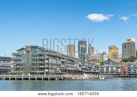 SYDNEY AUSTRALIA - OCTOBER 11 2016: Walsh Bay at Sydney Harbour. View of the residential apartments and Sydney skyline from a ferry on the harbour.