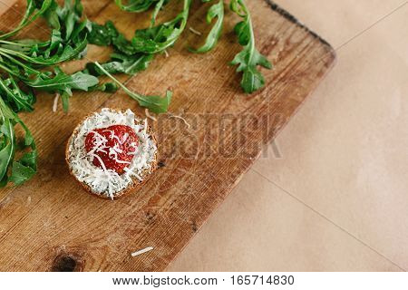 Delicious Fresh Canape With Gorgonzola Parmezan And Strawberry And Arugula On Wooden Desk, Top View