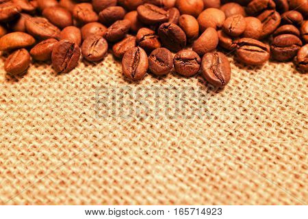 Pile of Coffee beans on burlap background