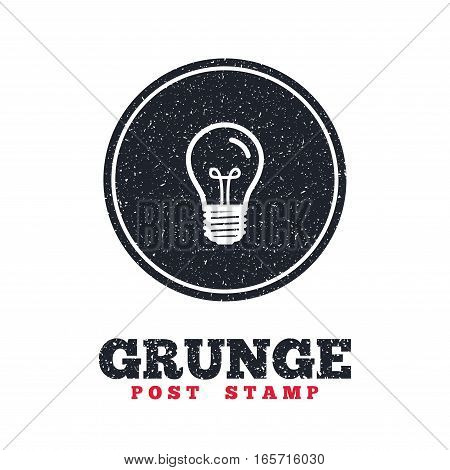 Grunge post stamp. Circle banner or label. Light bulb icon. Lamp E27 screw socket symbol. Illumination sign. Dirty textured web button. Vector
