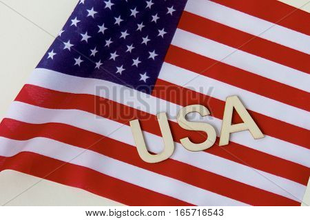 United States of America abbreviation on the American flag.