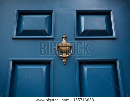 Blue modern classic door with bronze or metal knocker