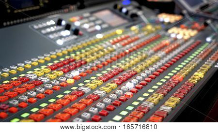 Professional audio mixing console with faders and adjusting knobs, TV equipment Black and White selective focus
