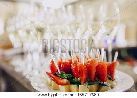 Fruit canapé of strawberries on a white saucer