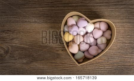 Hearts on the wooden background. Heart gift box. A lot of hearts. Valentine's Day gift.