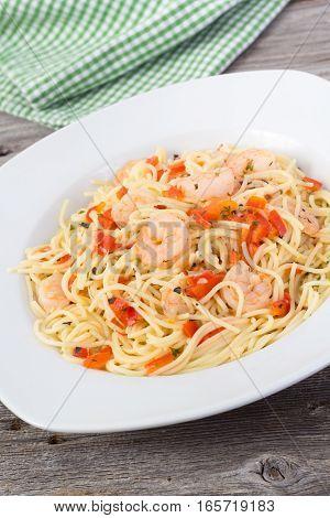 shrimp garlic pasta plate on wood table background