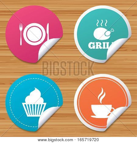 Round stickers or website banners. Food and drink icons. Muffin cupcake symbol. Plate dish with fork and knife sign. Hot coffee cup. Circle badges with bended corner. Vector