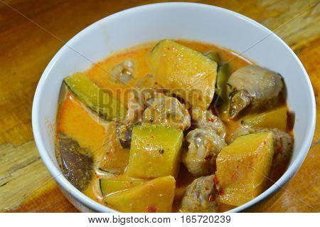 spicy pumpkin with ligament chicken in coconut cream curry on bowl