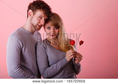 Girl With Boy Showing Hearts.