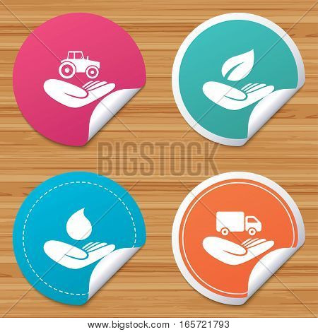 Round stickers or website banners. Helping hands icons. Agricultural tractor insurance symbol. Delivery truck sign. Save nature leaf and water drop. Circle badges with bended corner. Vector