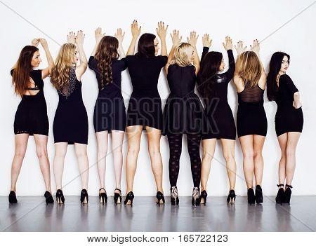 Many diverse women in line, wearing fancy little black dresses, party makeup, vice squad concept, lifestyle party people