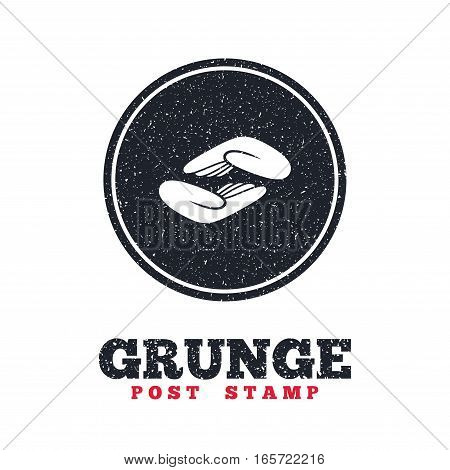 Grunge post stamp. Circle banner or label. Helping hands sign icon. Charity or endowment symbol. Human palm. Dirty textured web button. Vector