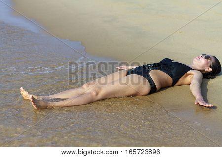Lady body symbol relax on sand in Ban Krut Beach at Prachuap Khirikhun Province Thailand