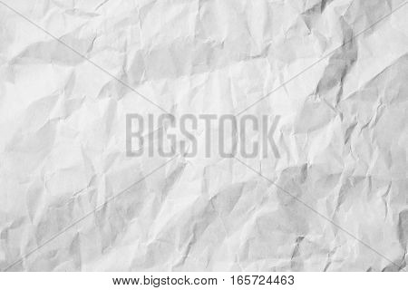 White crumpled paper floor texture background. Top view of grey pastel book cover above. Brown sepia dirty surface light and board grain. Scene painted pattern vintage style.