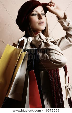 Portrait of young beautiful women with her shopping bags (retro tones)