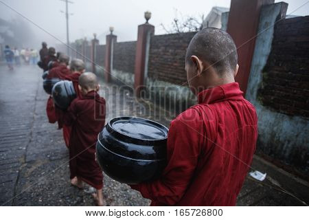 Buddhist novices walking for alms in Myanmar.