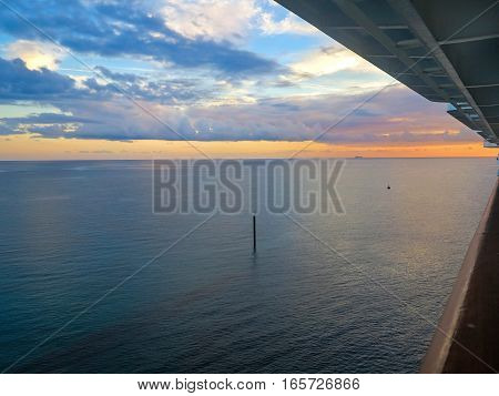 A sunset over the ocean from a cruise ship