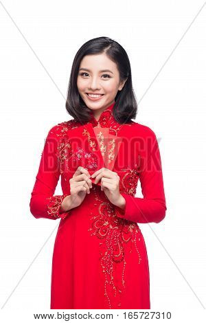 Beautiful Asian woman holding red pocket - lucky money. Tet holiday. Lunar New Year. Text mean Happiness and Lucky