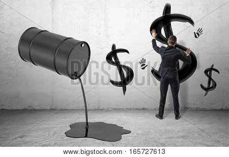 Businessman on concrete background leaving black palm prints beside USD signs and a black barrel nearby leaking oil. Business and money. Oil and gas industry. Commodity trade.
